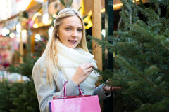 Blond woman at a holiday fair Royalty Free Stock Image