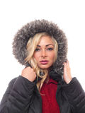 Blond woman in a hood. A attractive bond woman ie looking into the camera unsmiling Royalty Free Stock Photography
