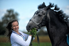 Blond woman with a horse Stock Photography
