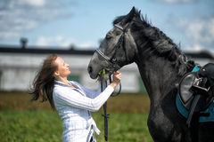 Blond woman with a horse Royalty Free Stock Photo