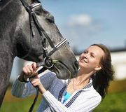 Blond woman with a horse Royalty Free Stock Images