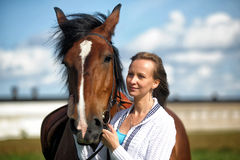 Blond woman with a horse Royalty Free Stock Photography
