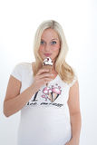 Blond woman with ice cream Stock Photos