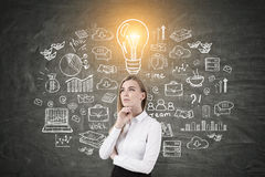 Blond woman and idea scheme Royalty Free Stock Photos