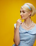 Blond woman isolated on yellow Stock Photo