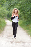 Blond woman is jogging Royalty Free Stock Image