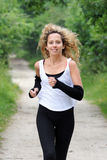 Blond woman is jogging Stock Images