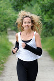 Blond woman is jogging Royalty Free Stock Photos