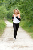 Blond woman is jogging Royalty Free Stock Photography