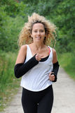Blond woman is jogging Stock Photos