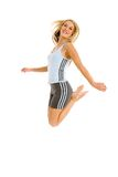 Blond woman jumping. Jeanne-Marie jumping with joy in her gym outfit Royalty Free Stock Image