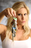 Blond woman with the key Royalty Free Stock Photo