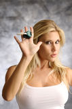 Blond woman with the key Royalty Free Stock Photos