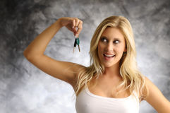Blond woman with the key Stock Photography