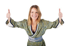 Blond woman in kimono with thumbs up Royalty Free Stock Photos