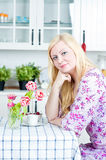 Blond woman in the kitchen Royalty Free Stock Images