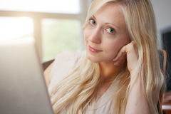 Blond woman with laptop Royalty Free Stock Photo
