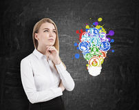 Blond woman and light bulb business icons Royalty Free Stock Photos