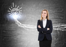 Blond woman and light bulb with wires Royalty Free Stock Image