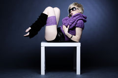Blond woman in light violet Stock Images