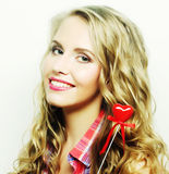 Blond  woman with little red heart Stock Image