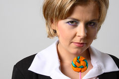 Blond woman with lollipop. Blond woman with multi-coloured lollipop landscape view stock images