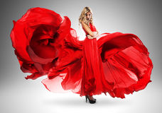 Blond woman in long beautiful red dress Royalty Free Stock Photography