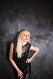 Blond woman in a long black evening dress Royalty Free Stock Image