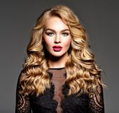 Blond woman with long curly beautiful hair. stock photo
