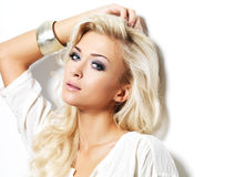 Blond woman with long curly hairs Royalty Free Stock Image