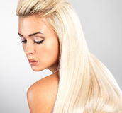 Blond woman with long straight hair Stock Images
