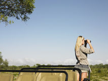 Blond Woman Looking Through Binoculars In Jeep Stock Images