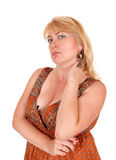 Blond woman looking mad. A portrait image of a blond woman in her forties looking mad into the Stock Image