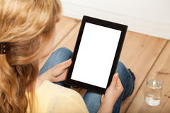 Blond woman looking at tablet Stock Image