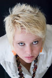 Blond woman looking up. With black background Royalty Free Stock Photography