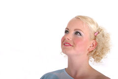 Blond woman looking up Stock Photo