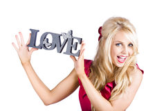 Blond woman with love sign Stock Photography