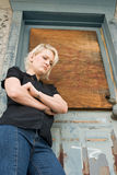 Blond Woman, Low View. Low angle portrait of a blond girl with boarded door in background Stock Photography