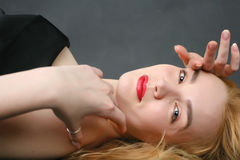 Blond woman lying on the floor-2 Stock Image