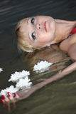 Blond woman lying in water Stock Image