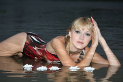 Blond woman lying in water Royalty Free Stock Image