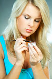 Blond woman with makeup Stock Image