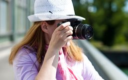 Blond woman making photoshootings Royalty Free Stock Image