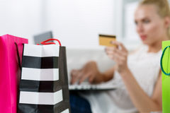 Blond woman making purchasing via internet paying credit card Stock Photo
