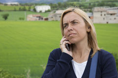 Blond woman making telephone call Royalty Free Stock Photography