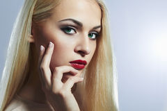 Blond woman with manicure.Beautiful girl model with make-up Royalty Free Stock Images