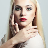 Blond woman with manicure.Beautiful girl model with make-up Stock Image