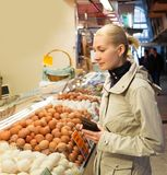 Blond woman on market Stock Photography