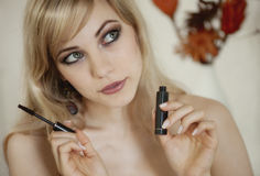 Blond woman with mascara Royalty Free Stock Photography