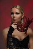 Blond woman and masquerade Royalty Free Stock Images